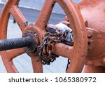 old rusty weather beaten round...   Shutterstock . vector #1065380972