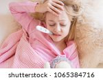 sick girl with thermometer in... | Shutterstock . vector #1065384716