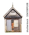 Small photo of Small decrepit, askew, shed from scrap wood with a gabled roof. Isolated on a white background