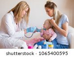 pediatrician doctor visiting... | Shutterstock . vector #1065400595