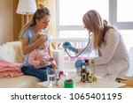 doctor visit sick baby at home | Shutterstock . vector #1065401195