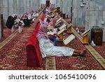 Small photo of Taif,Saudi Arabia-January 27th,2018:Group of Muslim worshipers sitting to recite the Quran in Abdullah Bin Abbas mosque. Abdullah bin Abbas RA is one of Prophet deciple who is expert in Tafsir Quran