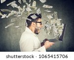 side view of man holding laptop ... | Shutterstock . vector #1065415706