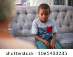 young boy having therapy with a ... | Shutterstock . vector #1065433235