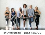 group portrait of young sporty... | Shutterstock . vector #1065436772