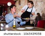 dissatisfied man expressing... | Shutterstock . vector #1065439058