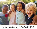 four kids hanging out together... | Shutterstock . vector #1065441956