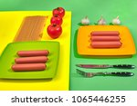a lot of raw sausages on plate. ... | Shutterstock . vector #1065446255