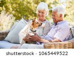 happy senior couple sitting...   Shutterstock . vector #1065449522
