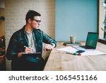 pensive hipster guy in eyewear... | Shutterstock . vector #1065451166