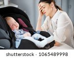 tired mother is sad near a... | Shutterstock . vector #1065489998