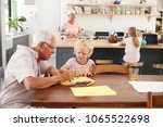grandparents and grandkids in... | Shutterstock . vector #1065522698