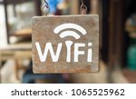 free wi fi wooden sign on... | Shutterstock . vector #1065525962