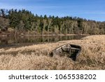wreck of a small boat on the... | Shutterstock . vector #1065538202