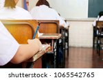 school student's taking exam... | Shutterstock . vector #1065542765