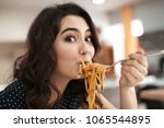 funny young woman eating tasty... | Shutterstock . vector #1065544895