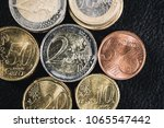 top view of euro coins on black ... | Shutterstock . vector #1065547442