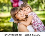 the small girl on hands of...   Shutterstock . vector #106556102