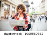 young beautiful female traveler ... | Shutterstock . vector #1065580982