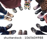 feet of people standing in a... | Shutterstock . vector #1065604988