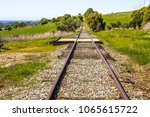 railroad tracks disappearing in ... | Shutterstock . vector #1065615722