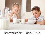 Children Eat Breakfast. Family...