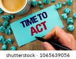Small photo of Writing note showing Time To Act. Business photo showcasing Action Moment Strategy Deadline Perform Start Effort Acting written by Man Holding Pen on Sticky Note Paper the jute background Cup