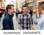 three man talk on the street...   Shutterstock . vector #1065645875