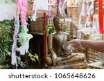 sprinkle water onto a buddha... | Shutterstock . vector #1065648626