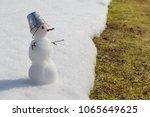 Miniature Snowman With A Bucke...