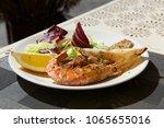 fresh king prawns and calamari... | Shutterstock . vector #1065655016