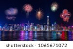 fireworks over the night hong... | Shutterstock . vector #1065671072