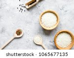 rice for paella on stone... | Shutterstock . vector #1065677135