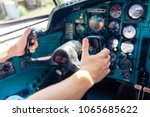 hands at the helm of the plane. ... | Shutterstock . vector #1065685622