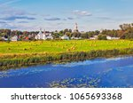 Landscape fields with rolls of hay and the river Kamenka, against the backdrop of the sights of Suzdal. Vladimir region. Gold ring. Russia