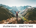 woman raised arms standing on... | Shutterstock . vector #1065727682