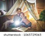 two cute little children are... | Shutterstock . vector #1065729065