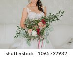 bride in a white dress with a... | Shutterstock . vector #1065732932