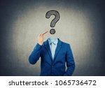 surreal image as a businessman... | Shutterstock . vector #1065736472