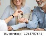 realtor giving senior aged... | Shutterstock . vector #1065757646