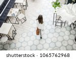 Stock photo business woman walking on the tiled floor in the modern cafe view from above 1065762968