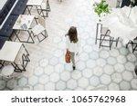 business woman walking on the... | Shutterstock . vector #1065762968