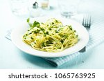 spaghetti with homemade parsley ... | Shutterstock . vector #1065763925