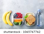 school lunch box with sandwich... | Shutterstock . vector #1065767762