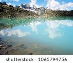 bright blue alpine lake. view... | Shutterstock . vector #1065794756