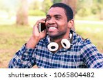 afro male phone calling... | Shutterstock . vector #1065804482