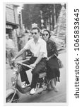 1950 Happy young couple on motorcycle