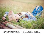beautiful young woman in hat... | Shutterstock . vector #1065834362