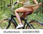 sexy young woman is riding on a ... | Shutterstock . vector #1065841985