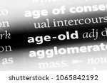 Small photo of age-old word in a dictionary. age-old concept.